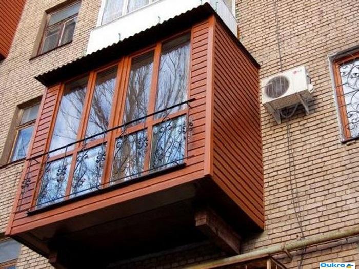 панорамный балкон обшитый сайдингом