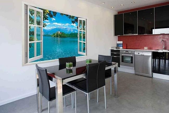 фотообои в виде окна с пейзажем на кухне