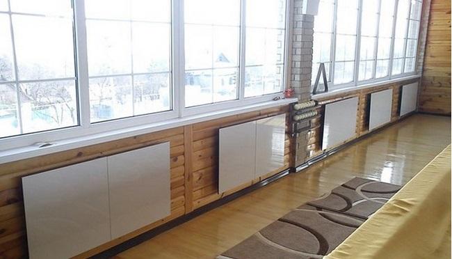 керамические обогреватели под окнами