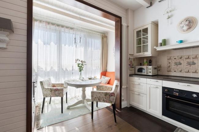 дизайн кухни с балконом 12 кв м с креслами и диванчиком